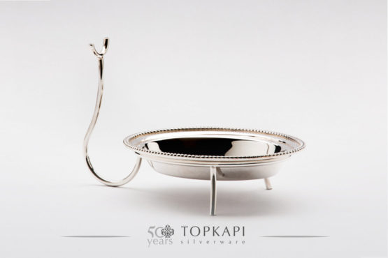 Oval silver plated serving spoon holder.